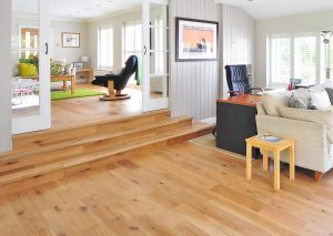 A hardwood floor in the living room above the crawlspace