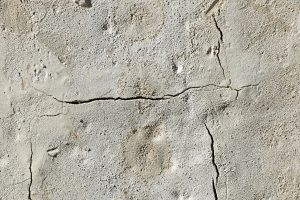 A concrete floor split with cracks.