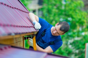 a-man-with-a-tool-during-the-repair-of-the-roof-of-the-house
