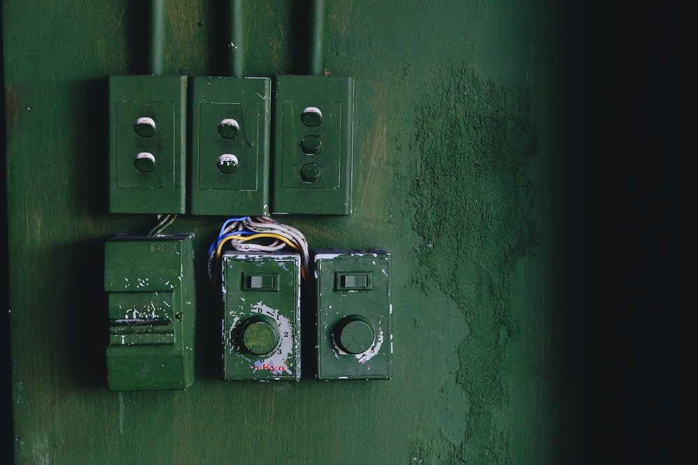 Electrical wiring in a damp basement leading to hazards